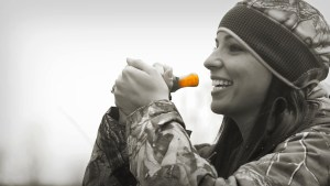 Cathy Brons practices with a duck call. Video capture by Jerry Neal/CPW.