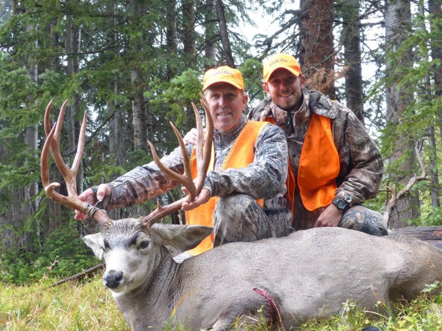 Steven Crockett and son Andrew celebrate after a successful hunt near Rabbit Ears Pass.