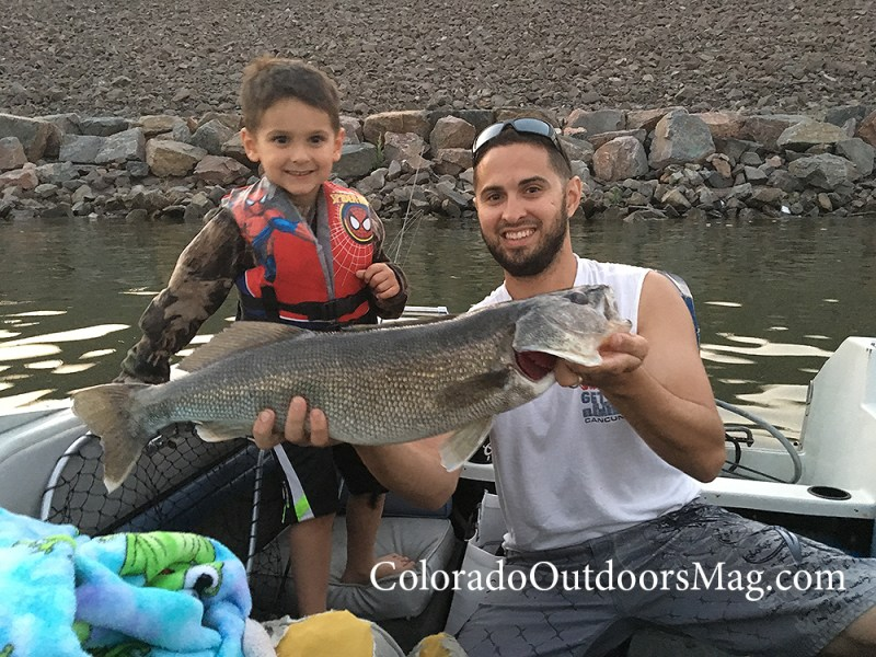 Tristan and Colin Evans show walleye catch