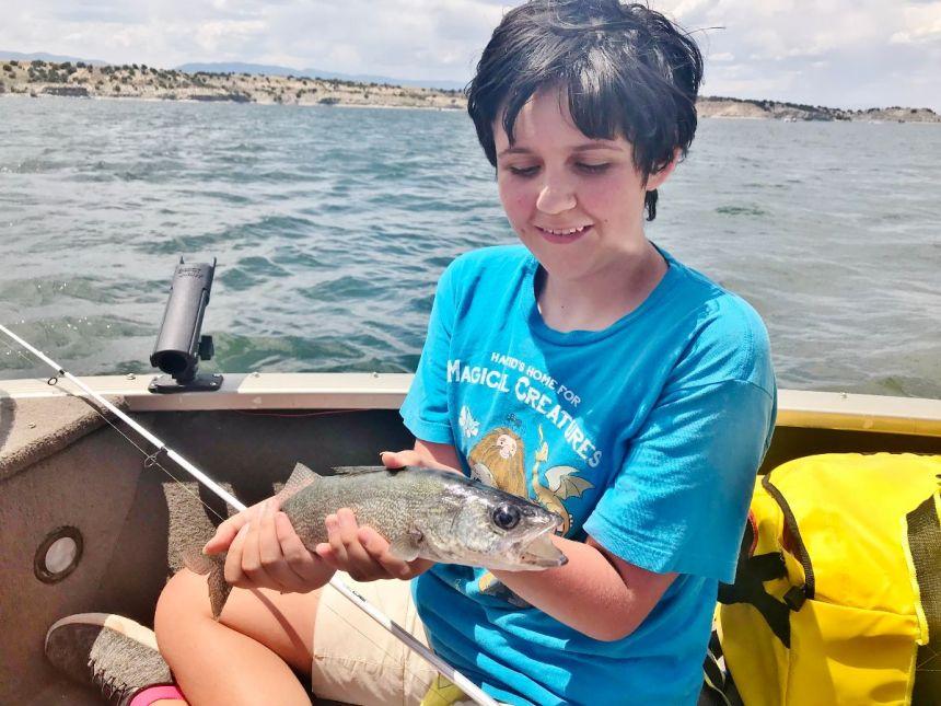 Natalie Duncan admires the walleye.