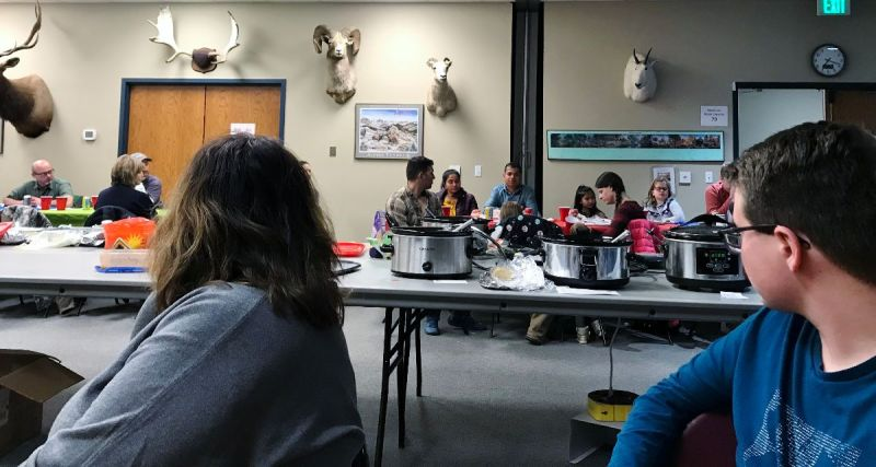 hungry RSP participants look at pots of homemade stews