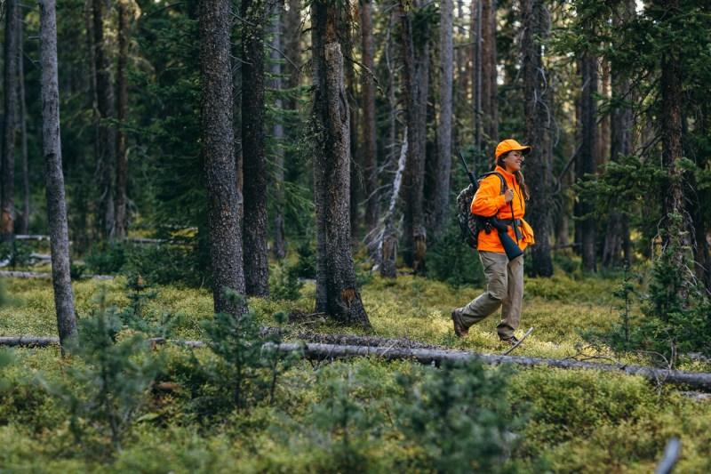 hunter walking through woods