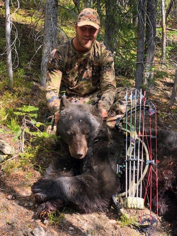 hunter with bear