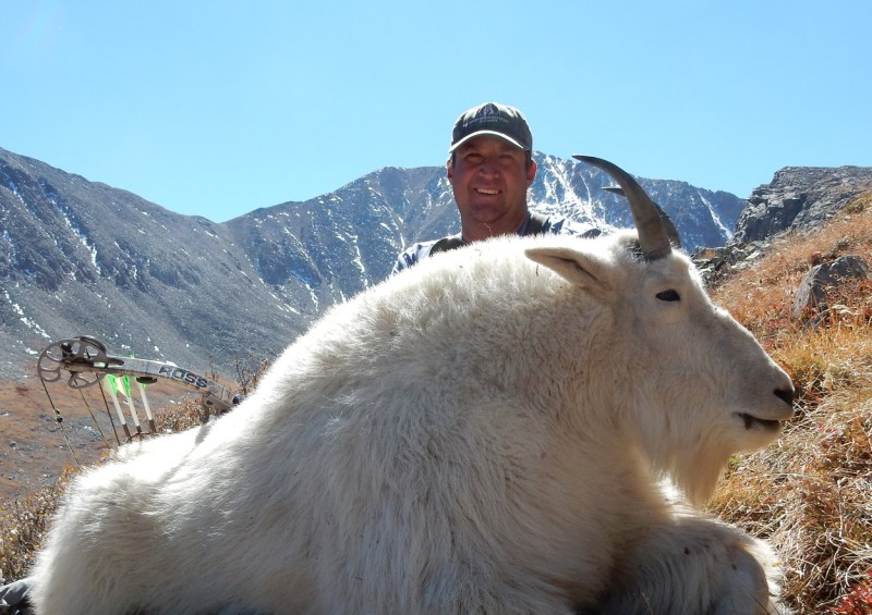hunter with mountain goat