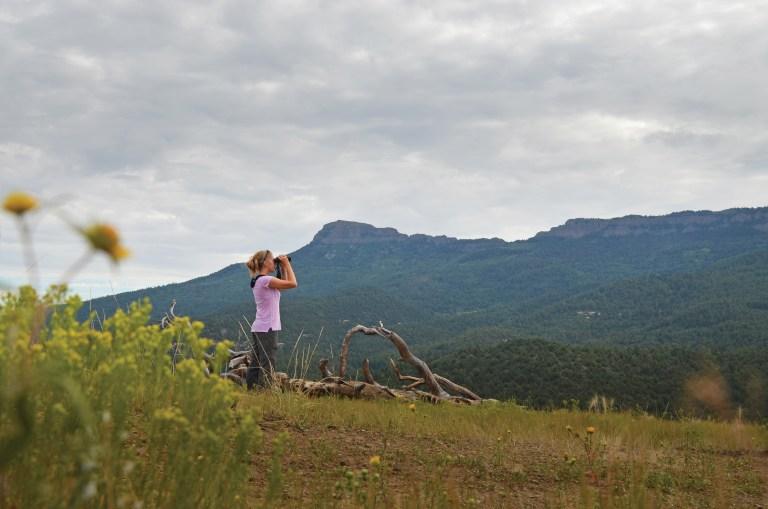 Park Manager Crystal Dreiling surveys Fishers Peak State Park.