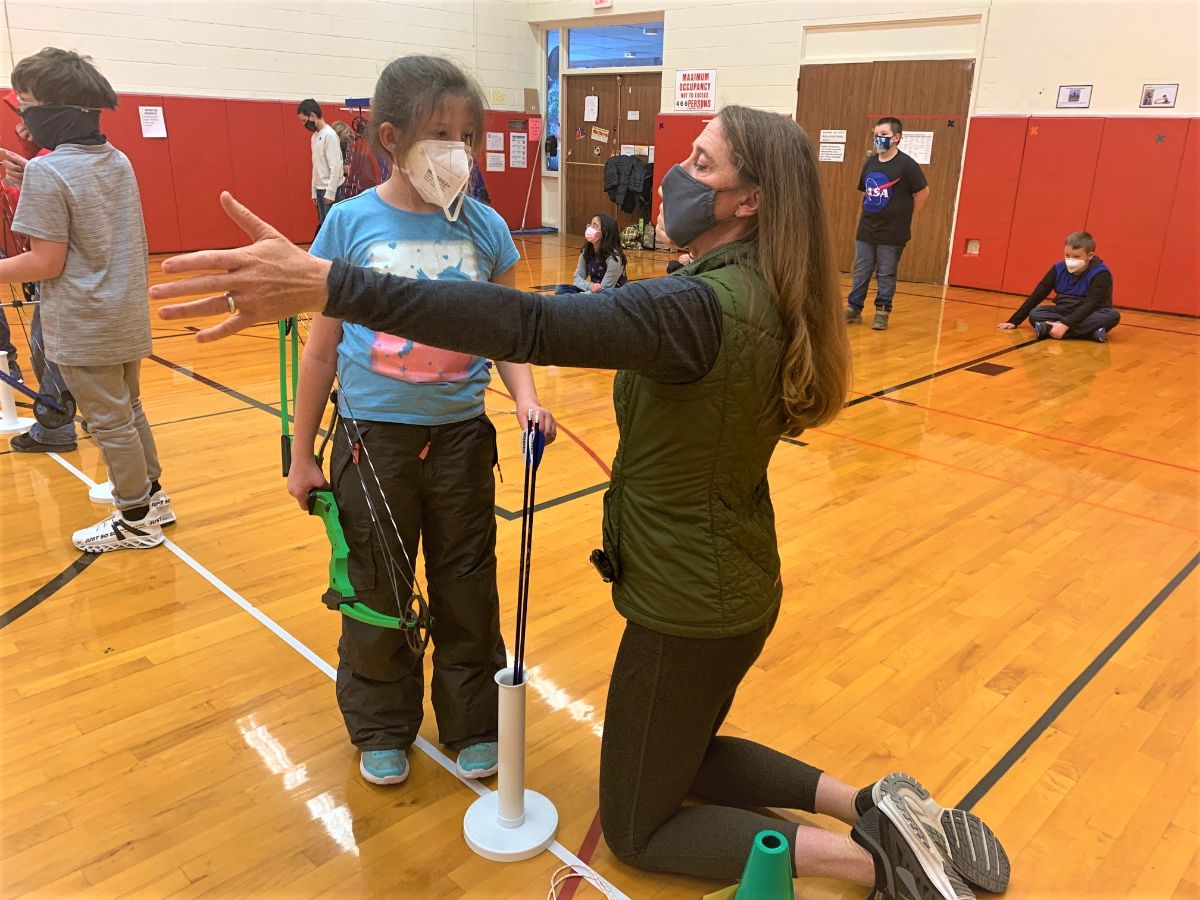 student learn archery
