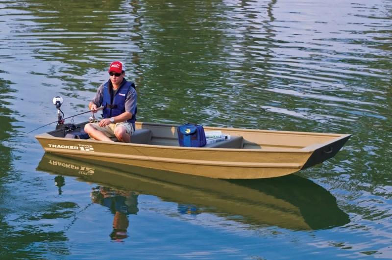 Angler in a jon boat