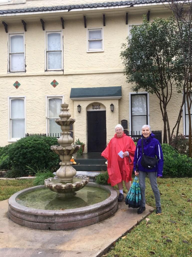 Carol and Mary by a pretty fountain.