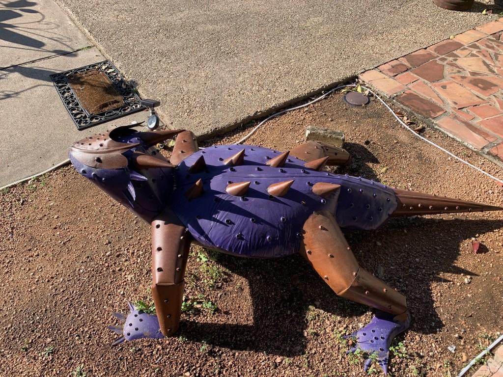 Yard art in Salado - a metal horny toad.