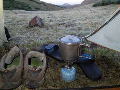 Shoes and cookstove at tent entrance