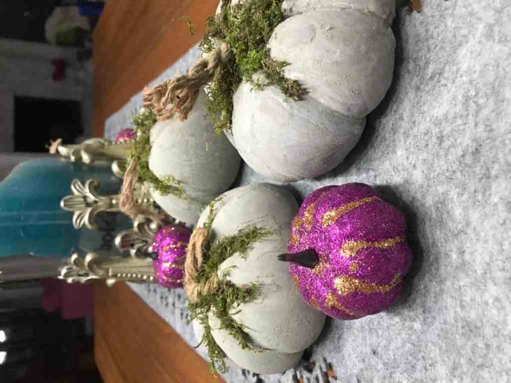 Decorate your dining room table with the DIY concrete pumpkins.