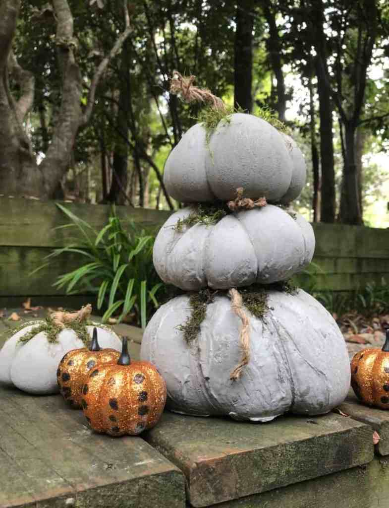 Decorate the concrete pumpkins in your front yard. How to make concrete pumpkins.