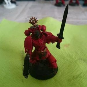 First base coats, Mephiston Red on the armor.