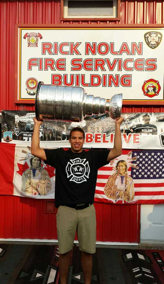 Jordan Nolan strikes a familiar pose with the Cup (Photo/Phil Pritchard, Hockey Hall of Fame).
