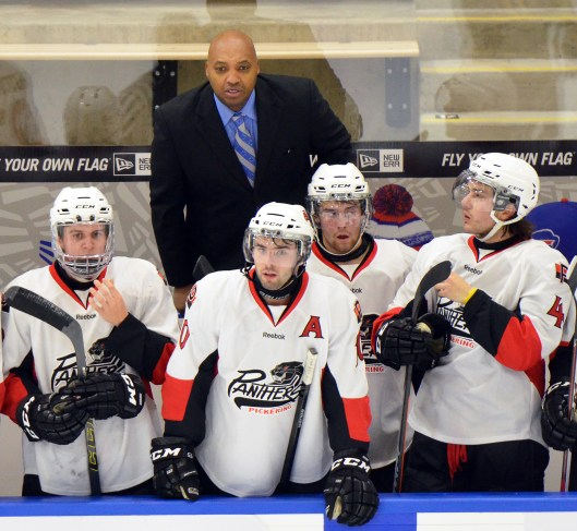 Cyril Bollers works the bench as assistant coach of the OJHL Pickering Panthers (Photo/Dan Hickling/Hickling Images)