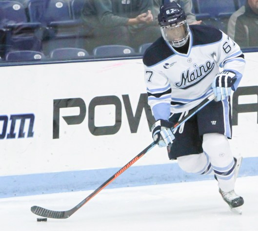 Malcolm Hayes in action for Maine's Black Bears. Hockey was a learning experience for his dad, a former Howard University football player.