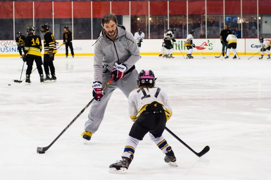 Alex Ovechkin shows Fort Dupont player how NHL defenders feel (Photo/Patrick McDermott).