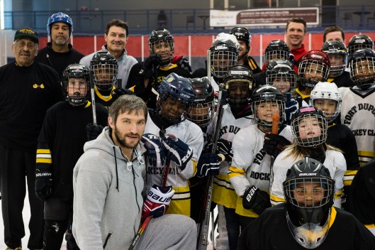 Neal Henderson, far left, and his Fort Dupont Ice Hockey Club  hang out with Washington Capitals forward Alex Ovechkin (Photo/Patrick McDermott).