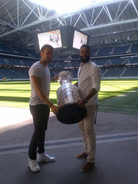 Johnny Oduya, right, and former Chicago Blackhawks teammate Marcus Kruger with the Cup at Friends Arena (Photo/Phil Pritchard, Hockey Hall of Fame).