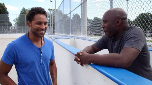 Damon Kwame Mason (right) interviews Chicago Blackhawks defenseman Trevor Daley for black hockey history documentary.