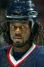 Anson Carter stuffed dreadlocks into his helmet during his NHL career.