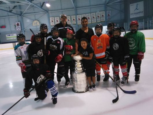 Pittsburgh Penguins defenseman Trevor Daley, center, brought a friend with him to a local ice rink - the Stanley Cup (Photo/Phil Pritchard/Hockey Hall of Fame).
