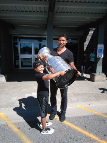 Pittsburgh Penguins defenseman Trevor Daley and son with the Stanley Cup in Sault Ste. Marie, Ont. (Photo/Phil Pritchard/Hockey Hall of Fame).