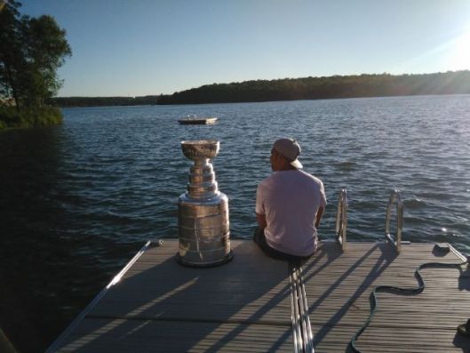 Sitting on the dock of the bay, Trevor Daley and the Stanley Cup watch the tide roll away (Photo/Phil Pritchard/Hockey Hall of Fame).