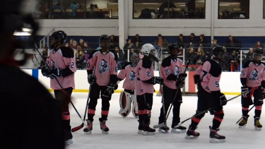 Proud and pink. The Tucker Road Ducks of Prince George's County, Maryland are practicing wherever and whenever they can after a January fire severely damaged their home rink.