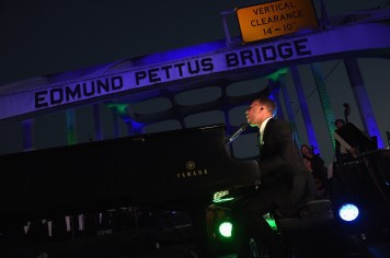 SELMA, AL - JANUARY 18: EDITORIAL USE ONLY- A special live performance on the Edmund Pettus Bridge by John Legend on January 18, 2015 in Selma, Alabama. (Photo by Rick Diamond/Getty Images for Paramount Pictures) *** Local Caption *** John Legend
