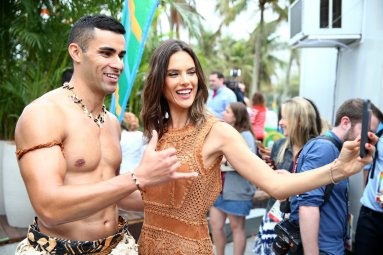 "TODAY -- Pictured: (l-r) Tongan flag bearer Pita Taufatofua and model Alessandra Ambrosio appear on NBC's ""TODAY"" show at the Rio Olympics on Monday, August 8, 2016 -- (Photo by: Joe Scarnici/NBC)"