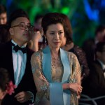 "Photo Credit: Sanja Bucko Caption: (L-R) NICO SANTOS as Oliver and MICHELLE YEOH as Eleanor in Warner Bros. Pictures' and SK Global Entertainment's and Starlight Culture's contemporary romantic comedy ""CRAZY RICH ASIANS,"" a Warner Bros. Pictures release."