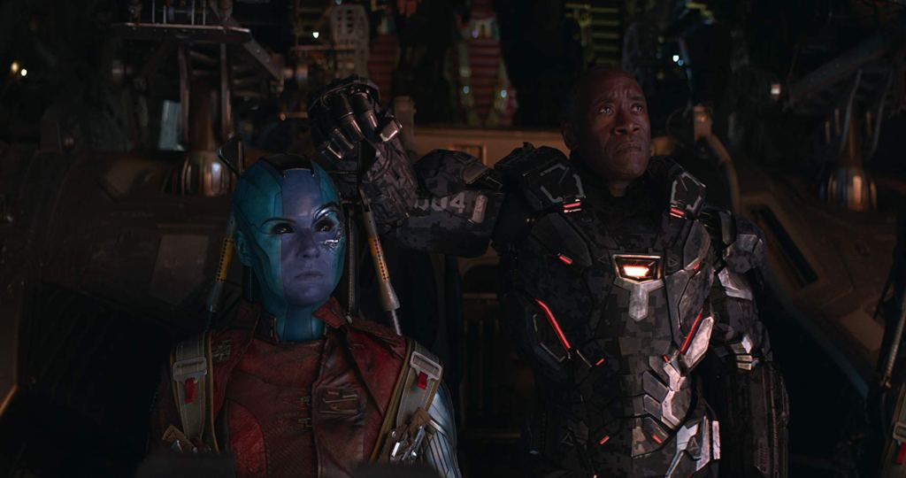 Nebula and War Machine look offscreen as they stand aboard Nebula's spaceship.