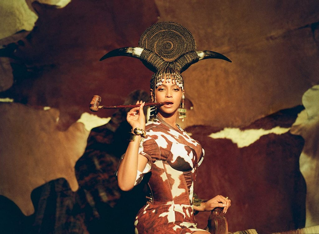 """Beyoncé in a cow-themed Afrocentric look in """"Black Is King."""" (Photo credit: Parkwood Entertainment)"""