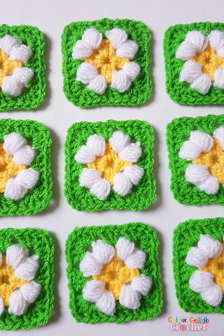 This is an easy crochet puff daisy granny square pattern for a small daisy flower in bright and cheerful colours.