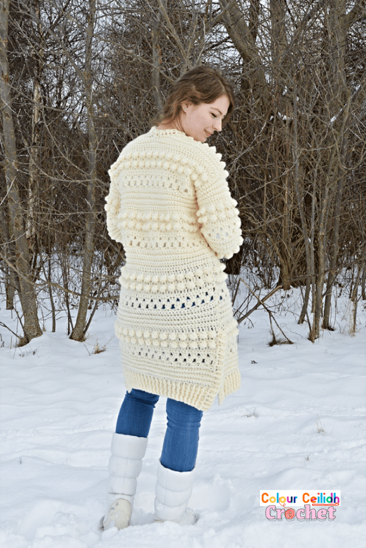 This free pattern for my crochet cardigan Bobbles of Snow is fun & easy to make as it uses the granny stitch and the bobble stitch to create cozy texture for the winter season. This is an open front long cardigan with added side slits for comfort and style. Includes a video tutorial.