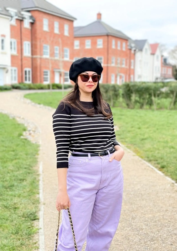 French style Mom jeans outfit with Purple trousers and striped fine knit jumper with a black beret