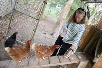 Tudy Moncure and her chickens.