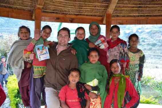 John Christopher '09 with Oda Foundation clients. Now in its third year of operation, the non-profit has assisted over 50,000 people, including 31,000 patients at a cost of $2.31 per medical visit. It also employs 15 local residents and tutors 150 children daily.