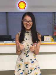 Laura Wang poses in the offices of Shell in China, where she completed a summer internship.