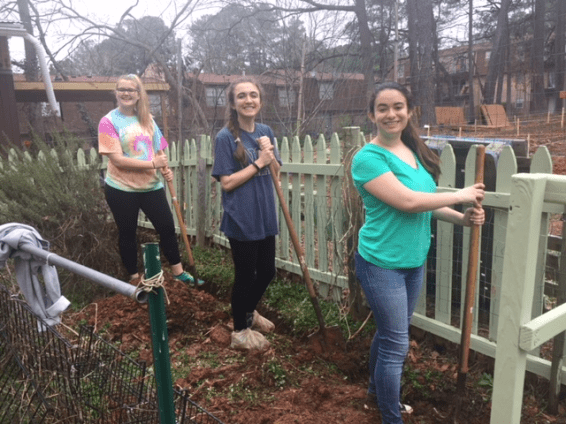 Students from the Nabors Service League helped with community gardening on their trip.