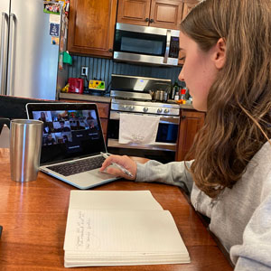 The Miami Hurricane's managing editor Anna Timmons virtually meets with staff and faculty advisor Tsitsi Wakhisi as she sits at her kitchen table. Photo: Anna Timmons/University of Miami