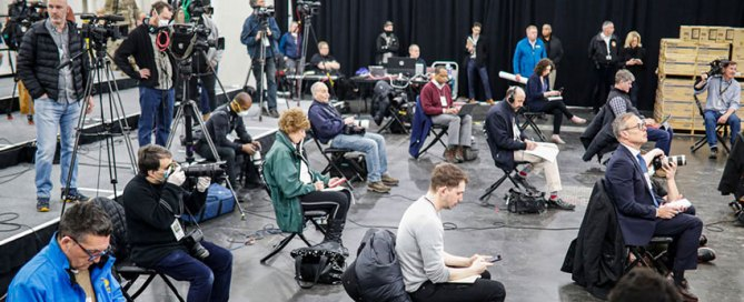 Journalists practice social distancing during a news conference with New York Gov. Andrew Cuomo on March 24. Photo: Associated Press