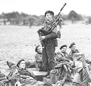British Army, 2nd Army, 1st Special Service Brigade, Piper Bill Millin by Capt JL Evans (3 June 1944)[edit-crop]