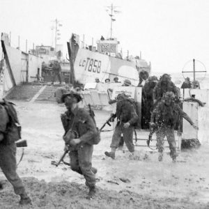 Gold Beach, British Army 50th (Northumbrian) Infantry Division coming ashore from Landing Craft Infantry near La Rivière-Saint-Sauveur, Normandy, 6 June 1944 [1180]