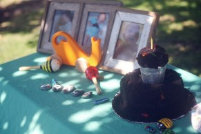 Delicious dirt cake, some wooden bug toys and pictures from Oakes' first year. (Epic dirt cake by Chawna)