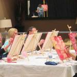 Cherry blossoms bloom on canvas in paint and wine class