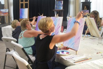 Backgrounds are applied in paint and wine class Grass Valley CA
