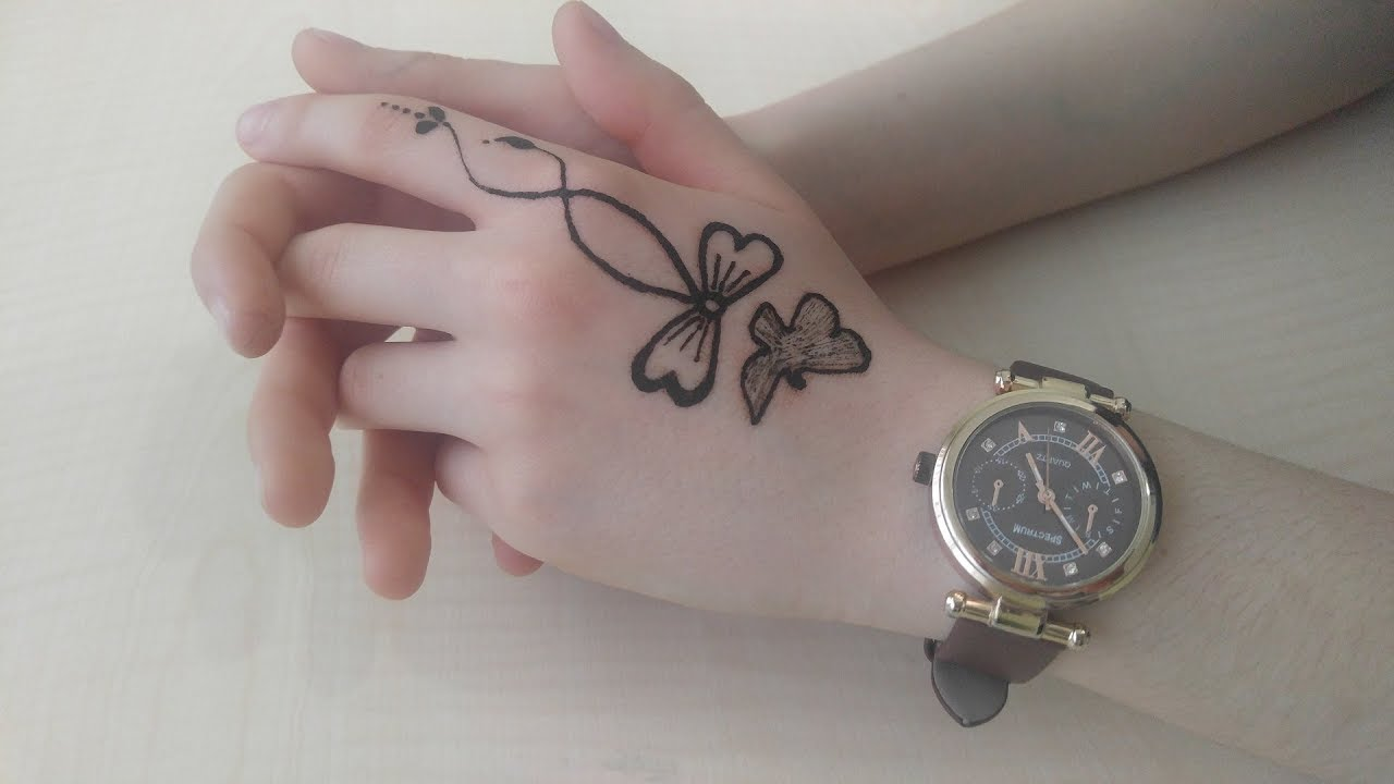 small eagle wrist band tattoo from this