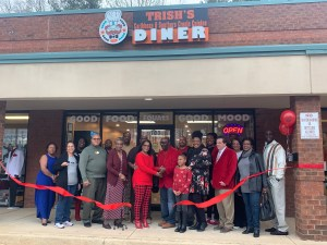 People standing outside new restaurant right after ribbon was cut